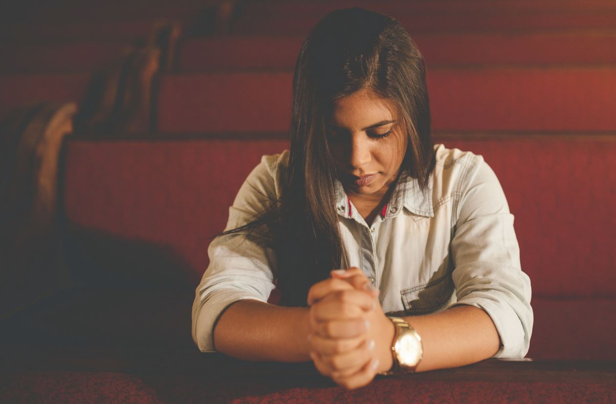 lady praying in church